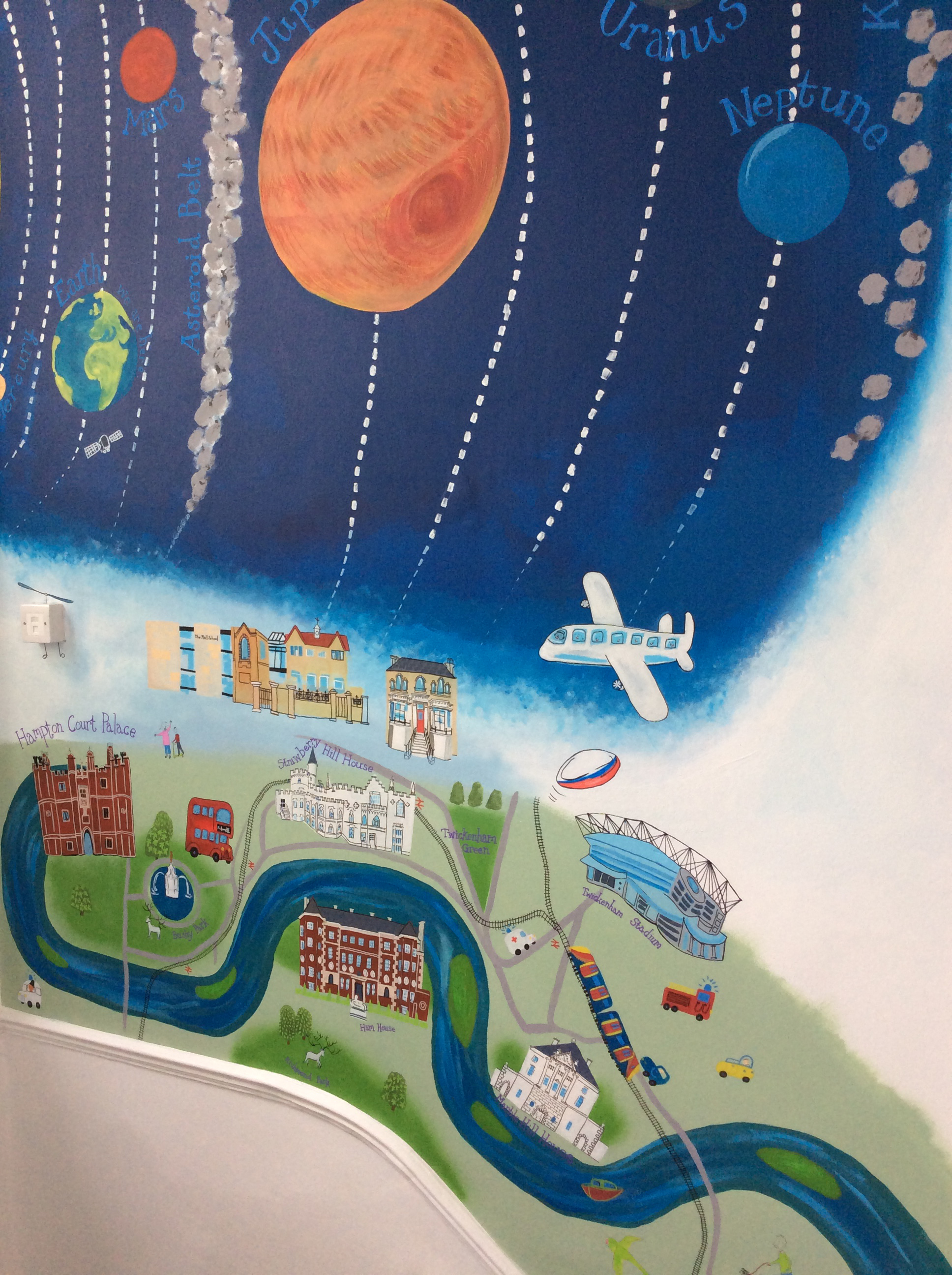 Section of a hand-painted mural at The Mall School